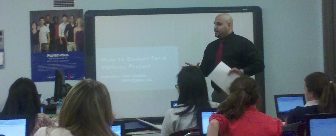 Juan Cuellar of OFFICEPRO, Inc leads a skills training on budgeting and Excel.